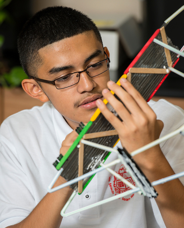 Students work on bridges at Furr High School, September 18, 2014.