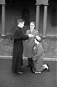 14/03/1964<br /> 03/14/1964<br /> 14 March 1964<br /> Ordination of Fr. Donal Sullivan at Holy Cross College (Clonliffe College), Clonliffe Road, Drumcondra, Dublin. Picture shows FFr. Donal Sullivan, C.M., Kenilworth, Ballinacurra, Co. Limerick, giving his first blessing to his mother, after his ordination. Centre is his father Mr P. Sullivan.