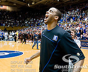 Duke Blue Devils forward Josh Hairston (15) getting crowd at Cameron ready for team introductions. Duke beats Maryland 71-64 at Cameron Indoor Stadium