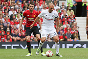 Michael Carrick All-Stars Eidur Gudjohnsen with \m16 watching on during the Michael Carrick Testimonial Match between Manchester United 2008 XI and Michael Carrick All-Star XI at Old Trafford, Manchester, England on 4 June 2017. Photo by Phil Duncan.