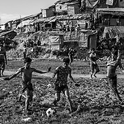 Rohingas refugees playing football in Balukhali refugee camp. Since the end of august 2017, the beginning of the crisis, more than 600,000 Rohingyas have fled Myanmar to  seek refuge in Bangladesh. Cox's Bazar -october 28th 2017.<br /> Des réfugiés Rohingyas juent au football dans le camp de Balukhali. Depuis le début de la crise, fin août 2017, plus de 600000 Rohingyas ont fuit la Birmanie pour trouver refuge au Bangladesh. Cox's Bazar le 28 octobre 2017.