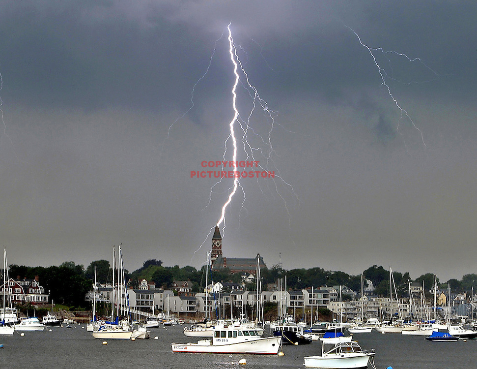 "(07/02/04-Marblehead,MA)""Landmark Takes direct hit"" - Wicked weather: Harbinger of a good weather weekend....Lightning appears to strike Abbot Hall shortly after 2pm today. ED Note This historic bldg houses the famous patriotic painting ""Spirit Of 76"". Marblehead harbor. (070204lightningmg-Mark Garfinkel photo"