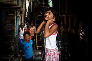 Rubina Ali, 9, the child actor playing the role of 'young Latika', the friend/lover of Jamal, protagonist of Slumdog Millionaire, the famous movie winner of 8 Oscar Academy Awards in December 2008, is smiling while on the streets near her uncle's house in the slum where she still lives with her family next to the train station of Bandra (East), Mumbai, India. Various promises were made to lift the two young actors (Azharuddin Ismail and Rubina Ali) from poverty and slum-life but as of the end of May 2009 anything is yet to happen. Rubina's house was recently demolished with no notice as it lay on land owned by the Maharashtra train authorities and she is now permanently living with her uncle's family in a home a stone-throw away in the same slum. Azharuddin's home too was demolished in the past two weeks, as it happens every year in his case, because the concrete walls were preventing local authorities to clear a drain passing right behind it. As usual, his father is looking into restoring the walls as soon as the work on the drain has been completed.