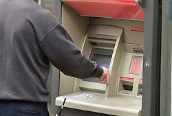 File photo dated 27/04/16 of a man using a cash machine outside in central London, as small firms are being let down by the accelerating closure of local bank branches, a business group has warned.