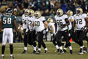 New Orleans Saints center Brian de la Puente (60) and teammates break from the offensive huddle and walk to the line of scrimmage during the NFL NFC Wild Card football game against the Philadelphia Eagles on Saturday, Jan. 4, 2014 in Philadelphia. The Saints won the game 26-24. ©Paul Anthony Spinelli