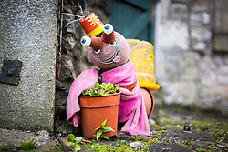 © Licensed to London News Pictures. 07/08/2017. Settle UK. Picture shows this years Settle Flower Pot festival in Settle in the Yorkshire Dales. The festival was started in 2004 & takes place throughout August, it see's local residents make a variety of creation's all made with flower pot's. of Photo credit: Andrew McCaren/LNP
