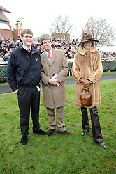 Left to right, NED SANGSTER and his parents GUY & FIONA SANGSTER at the Hennessy Gold Cup 2010 at Newbury Racecourse, Berkshire on 27th November 2010.