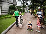 28 DECEMBER 016 - SINGAPORE: Tourists near the Fullerton hotel in Singapore.     PHOTO BY JACK KURTZ