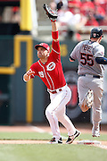 CINCINNATI, OH - JULY 19: Joey Votto #19 of the Cincinnati Reds stretches for the throw at first base against the Cleveland Indians during the game at Great American Ball Park on July 19, 2015 in Cincinnati, Ohio. The Indians defeated the Reds 5-3 in 11 innings. (Photo by Joe Robbins)  Joey Votto
