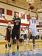 Washington Warrior's Aleena Hobbs (10) puts up a shot as Linn-Mar Lion's Sara Strauel (10) defends during their Regional Semi-Final game at Washington High School in Cedar Rapids on Saturday, February 16 2013.