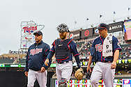 Ryan Doumit #9, Vance Worley #49, and Rick Anderson #40 head for the dugout before a game against the Boston Red Sox on May 17, 2013 at Target Field in Minneapolis, Minnesota.  The Red Sox defeated the Twins 3 to 2.  Photo: Ben Krause