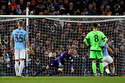 Manchester City forward Sergio Aguero (10) berats FC Schalke 04 goalkeeper Ralf Fahrmann (1) from the penalty spot during the Champions League round of 16, leg 2 of 2 match between Manchester City and FC Schalke 04 at the Etihad Stadium, Manchester, England on 12 March 2019.