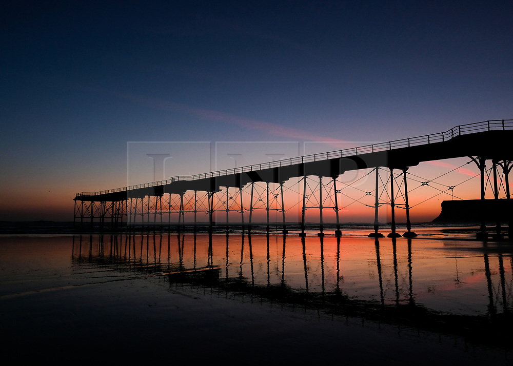 © Licensed to London News Pictures. <br /> 06/04/2017<br /> Saltburn-by-the-Sea, UK. <br />  <br /> The sun rises at Saltburn-by-the-Sea in North Yorkshire. <br /> <br /> <br /> Photo credit: Ian Forsyth/LNP