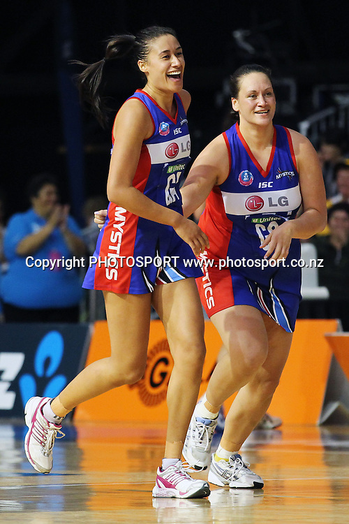 Mystics' Maria Tutaia and Cathrine Latu run towards their teammates in celebration. ANZ Netball Championship, Preliminary Final, Waikato/BOP Magic v LG Northern Mystics. Mystery Creek Events Centre, Hamilton, New Zealand. Sunday 15th May 2011. Photo: Anthony Au-Yeung / photosport.co.nz