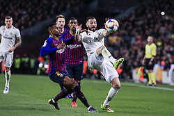 February 6, 2019 - Barcelona, Spain - 09 Karim Benzema of Real Madrid defended by 02 Nelson Semedo of FC Barcelona during the semi-final first leg of Spanish King Cup / Copa del Rey football match between FC Barcelona and Real Madrid on 04 of February of 2019 at Camp Nou stadium in Barcelona, Spain  (Credit Image: © Xavier Bonilla/NurPhoto via ZUMA Press)