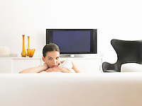 Woman sitting on sofa in modern living room