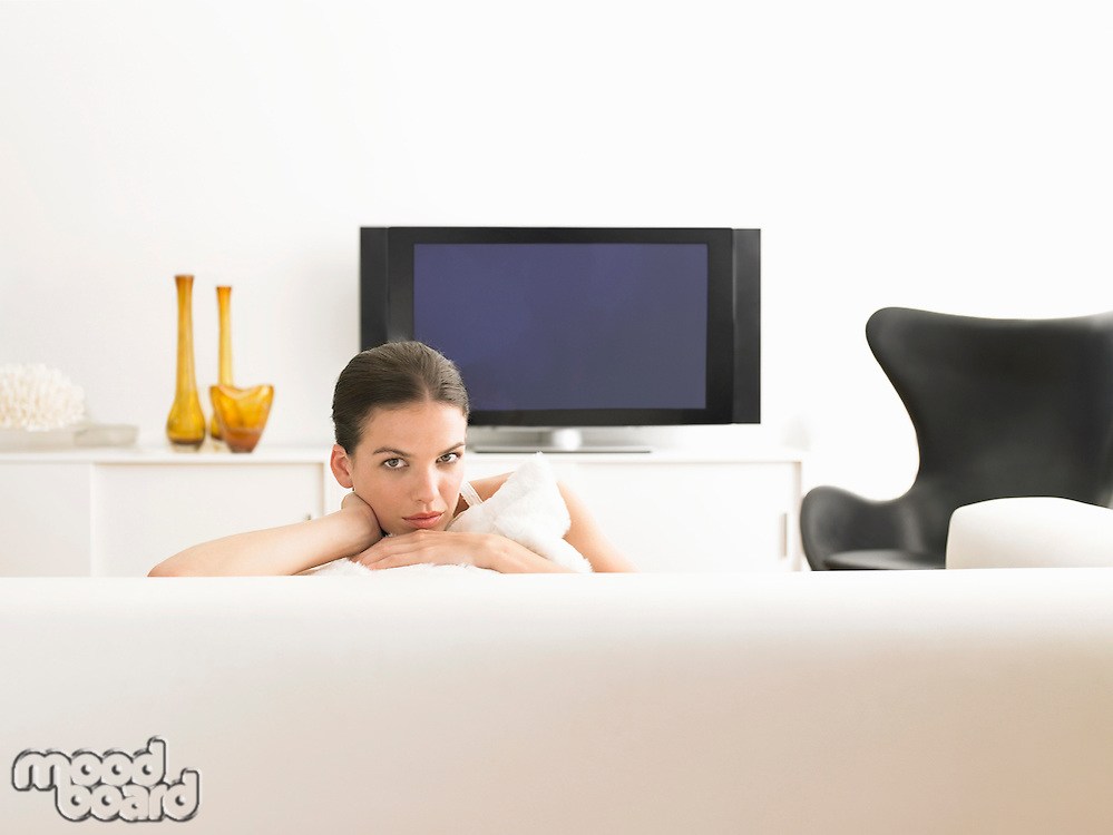 Woman sitting on sofa in modern living room