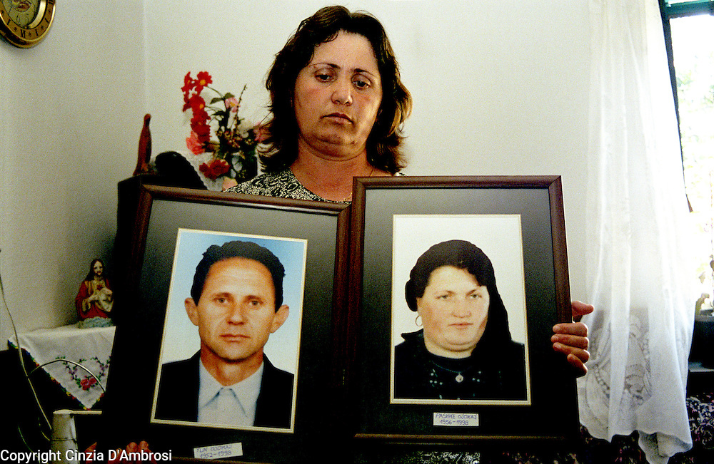 Ageja Sokoli. Widow of war. Her four sons are still missing and husband were taken away by the serbian police in a night raid.  She has never seen them since. Their bodies have never been found. She is holding a picture of her husband and of herself.