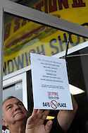 Richard Reid, Owner of the Sub Station II on Franklin Blvd in Gastonia, NC posts a sign regarding his restarant's flu precautions, inside the entry door