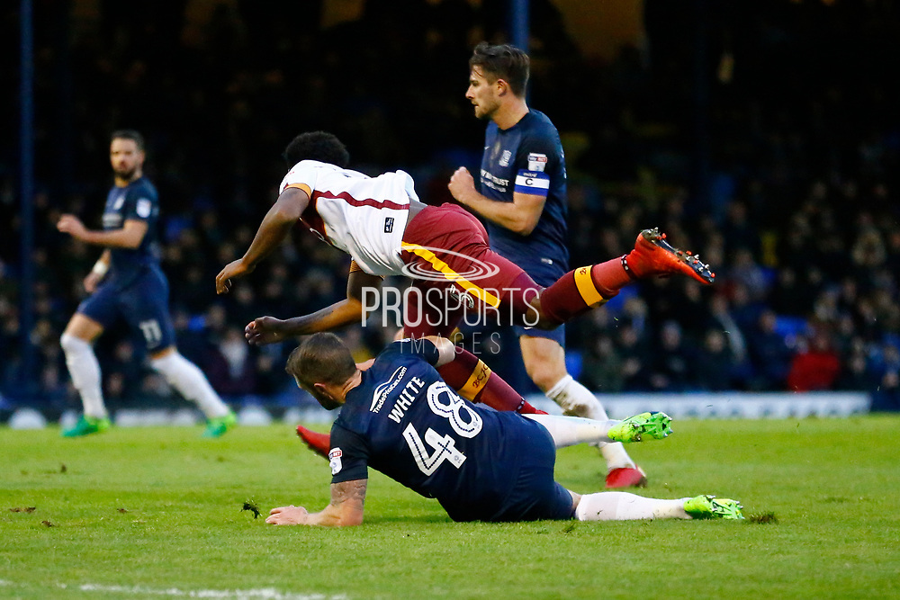 Southend's defender John White puts in a brave tackle on Bradford's midfielder Tyrell Robinson during the EFL Sky Bet League 1 match between Southend United and Bradford City at Roots Hall, Southend, England on 16 December 2017. Photo by Matt Bristow.
