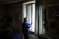 VERBANIA, ITALY - 18 APRIL 2017: Rosemarie Santoni, the wife of one of Emma Morano's nephews who assisted her, opens the window of Emma Moran's small room in Verbania, Italy, on April 18th 2017.<br /> <br /> Emma Morano, born in 1899, was an Italian supercentenarian who, prior to her death at the age of 117 years and 137 days, was the world's oldest living person whose age had been verified, and the last living person to have been verified as being born in the 1800s. She died on April 15th 2017.