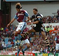 Photo: Ian Hebden.<br />Aston Villa v Charlton Athletic. The Barclays Premiership. 23/09/2006.<br />Villa's Juan Pablo Angel (L) and Charlton's Talal El Karkouri (R) contest a header.