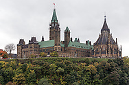 The Library of Parliament and the Centre Block building on Parliament Hill in Ottawa, Ontario, Canada. The Library of Parliament is the only original part of the original Centre Block after it burned down in 1916.  The library clerk at the time had the presense of mind to close the large iron doors before the fire reached the library.