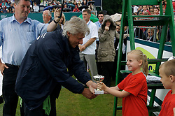 Liverpool, England - Wednesday, June 13, 2007: Bjorn Borg presents a children's award on a rainy and wet centre court  at Calderstones during action on day two of the Liverpool International Tennis Tournament. Bjorn was scheduled to play his first match on grass since 1981 but was forced to withdraw after a dog bit his leg. For more information visit www.liverpooltennis.co.uk. (Pic by David Rawcliffe/Propaganda)
