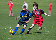 12/05/2018 - Clarks FC (blue and black) v Dundee City (red and black) in the Dundee Saturday Morning Football League at Drumgeith, Dundee, Picture by David Young -