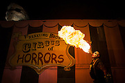 Scorch spits fire Thursday at the entrance to the Freakling Bros. Trilogy of Terror haunted houses which are celebrating their 21st year in Vegas. They were the the first free-standing haunt in town and feature the state's only R-rated house in the Gates of Hell.