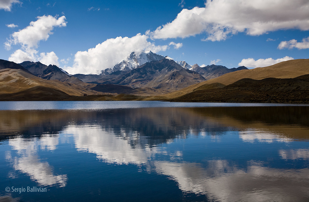 Reflections of Mt. Huayna Potosi in the Tuni Reservoir below the Cordillera Real, Bolivia in winter.