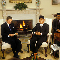 U.S. President Ronald Reagan meets with Indonesian President H. Muhammad Suharto in the Oval Office of the White House in October 1982 in Washington, DC.