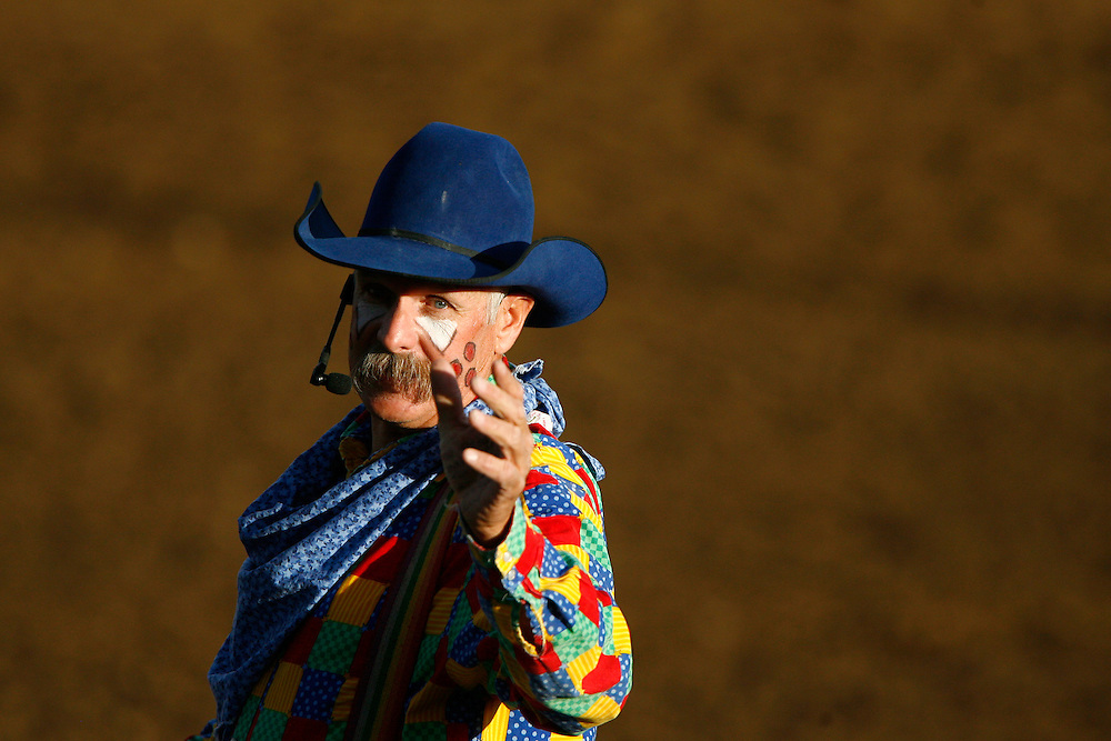 "061810-Evergreen, COLORADO-pbr-Barrelman Kevin Higley entertains the crowd in between riders during the 3rd annual PBR ""Friday Night Bulls"" competition Friday, June 18, 2010 at the El Pinal Rodeo Arena..Photo By Matthew Jonas/Evergreen Newspapers/Photo Editor"