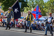 30 JUNE 2012 - PRESCOTT, AZ:  Confederate reenactors of the American Civil War period march in the Prescott Frontier Days Rodeo Parade. The only civil war battle in the west was fought in Arizona, at Picacho Peak, north of Tucson. The parade is marking its 125th year. It is one of the largest 4th of July Parades in Arizona. Prescott, about 100 miles north of Phoenix, was the first territorial capital of Arizona.    PHOTO BY JACK KURTZ