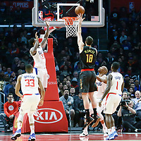 08 January 2018: Atlanta Hawks center Miles Plumlee (18) goes for the baby hook over LA Clippers guard C.J. Williams (9) and LA Clippers guard Lou Williams (23) during the LA Clippers 108-107 victory over the Atlanta Hawks, at the Staples Center, Los Angeles, California, USA.