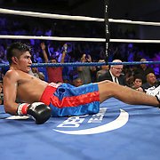 """Juan Kantun lies on the mat after being knocked out during a """"Boxeo Telemundo"""" boxing match at the Kissimmee Civic Center on Friday, July 18, 2014 in Kissimmee, Florida.  Jonathan Vidal won the bout by TKO. (AP Photo/Alex Menendez)"""