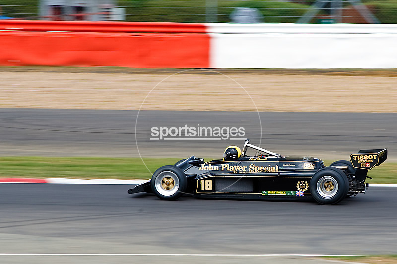 Car No 18 heads around Abbey. Silverstone Classic - 66-85 F1- 25/7/10.