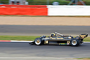 Car No 18 heads around Abbey. Silverstone Classic - 66-85 F1- 25/7/10.