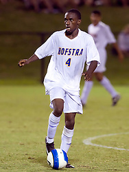 Hofstra defender Jamal Neptune (4) in action against UVA.  The Virginia Cavaliers defeated the Hofstra Pride 4-2 in NCAA men's soccer at Klockner Stadium on the Grounds of the University of Virginia in Charlottesville, VA on September 7, 2008