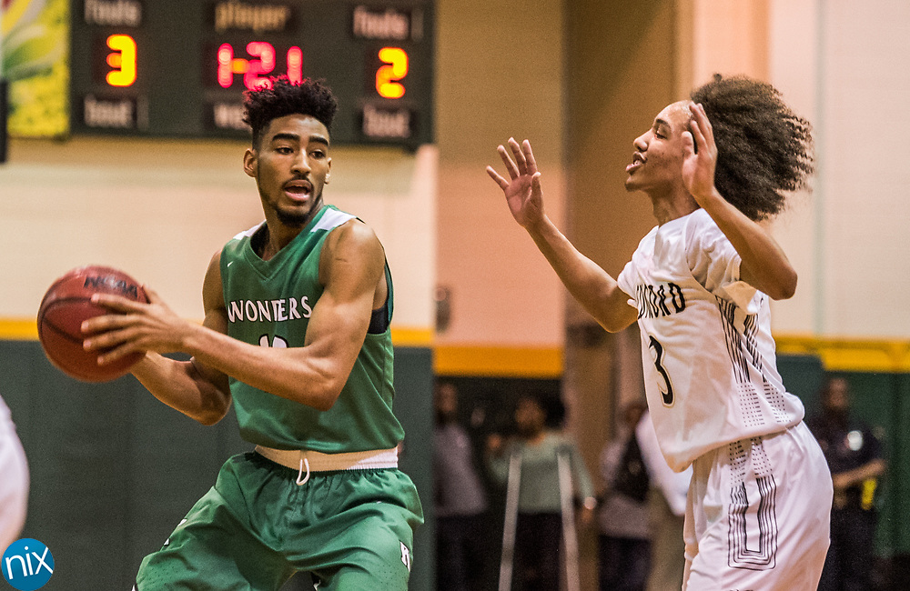 Kannapolis' JD Glenn (23) looks to get the ball past Concord's Jonah Mott (3) during a South Piedmont Conference basketball game Saturday night at Central Cabarrus High School.