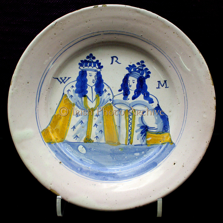 Plate. King William and Queen Mary, probably London, Lambeth, about 1690-1695.  Inscribed M W R.  These portraits are usually stylised, as are many of the other royal portraits found in English tin-glaze.