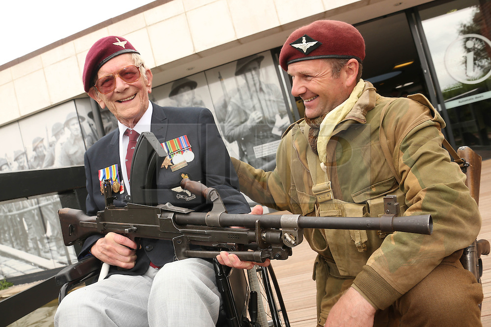 © Licensed to London News Pictures. 03/06/2014. Portsmouth, UK. PORTSMOUTH - D DAY MUSEUM - RAY SHUCK AGED 91 A BREN GUNNER FROM THE PARACHUTE REGIMENT WHO DROPPED INTO RANVILLE ON D DAY WITH RE ENACTIOR MARTIN FIELDEN . Photo credit : Jason Bryant/LNP