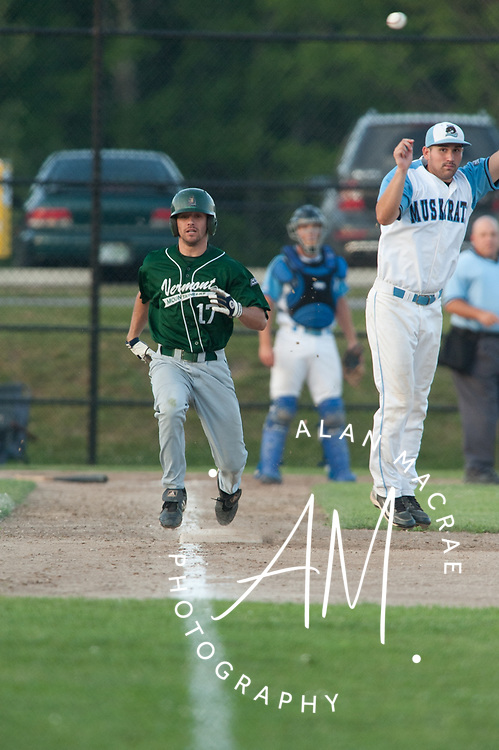 Muskrats' first baseman Adam Kirsch misses the throw as Vermont Mountaineers' Thomas Pope cruises to first during Monday night's game at Robbie Mills Memorial Sports Complex in Laconia.  (Alan MacRae/for the Citizen)