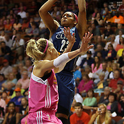 Maya Moore, (right), Minnesota Lynx, shoots while defended by Katie Douglas, Connecticut Sun, during the Connecticut Sun Vs Minnesota Lynx, WNBA regular season game at Mohegan Sun Arena, Uncasville, Connecticut, USA. 27th July 2014. Photo Tim Clayton
