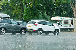 © Licensed to London News Pictures. 12/08/2020.  Builth Wells, Powys, Wales, UK. After a sweltering day with temperatures reaching 32 deg C, people get caught out by massive thunderstorms and torrential downpour in Builth Wells in Powys, Wales, UK. Photo credit: Graham M. Lawrence/LNP