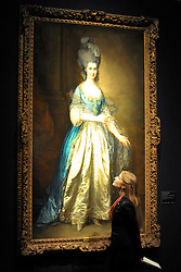 © licensed to London News Pictures. LONDON, UK.  13/06/11. A gallery assistant looks at Thomas Gainsborough's 'Portrait of Miss Read, later Mrs William Villebois. The portrait shows the granddaughter of celebrated brewer Sir Benjamin Truman. It is expected to fetch £4-6Million at auction on 5 July 2011. Photo call at Christie's, London, for the unveiling of rarely seen masterpieces by Picasso, Michelangelo and Gainsborough before they are offered for sale. Photo credit should read Stephen Simpson/LNP
