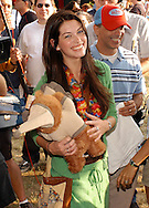 "ATLANTIC CITY, NJ - JUNE 26: Maxim Magazine cover model Kim Smith holds the teddy bear which she won playing a game  during the Maxim Magazine Presents ""Fantasy Island"" at the Borgata Hotel Casino and Spa June 26, 2004 in Atlantic City, New Jersey. The event consisted of two music stages and four unique themed areas, providing a wide array of entertainment for guests; South Beach Venice Beach, Stuffland, and The Oasis. (Photo by William Thomas Cain/Getty Images)"