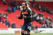 Blackpool Forward Nathan Delfouneso (30) celebrates to the Blackpool fans at full time as they beat Doncaster 0-1 during the EFL Sky Bet League 2 match between Doncaster Rovers and Blackpool at the Keepmoat Stadium, Doncaster, England on 17 April 2017. Photo by Craig Zadoroznyj.