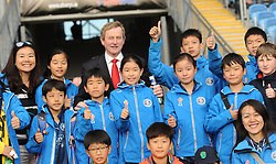 An Taoiseach Enda Kenny TD poses for photos with members of the Shanghai GAA Club at McHale Park on saturday evening last.<br />Pic Conor McKeown