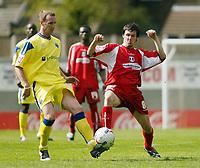 Photo: Chris Ratcliffe.<br />Leyton Orient v Peterborough United. Coca Cola League 2. 29/04/2006.<br />Craig Easton (R) of Leyton Orient tussles with Peter Gain of Peterborough.